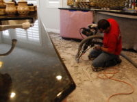 A picture of our demolition expert removing tile in gilbert arizona dust free.