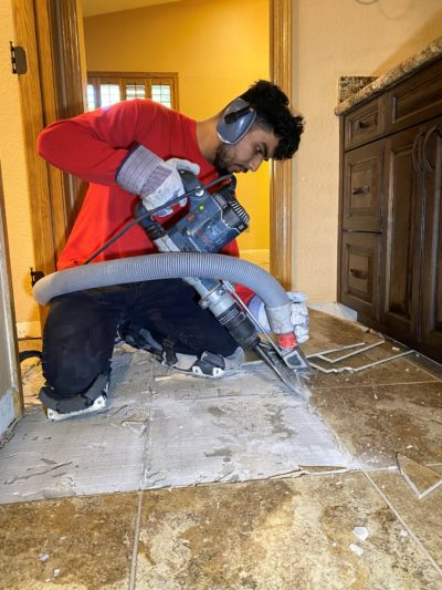 A picture of a DustSharkz dust free tile removal expert removing tile in Glendale