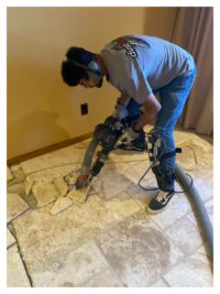 DustSharkz Dust Free Flooring Removal expert removing tile in a home in Fountain Hills.